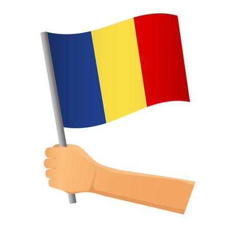 Romania flag in hand. Patriotic background. National flag of Romania  illustration Imagens