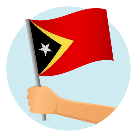 East Timor flag in hand. Patriotic background. National flag of East Timor vector illustration