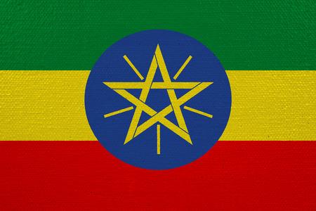 Ethiopia flag on canvas. Patriotic background. National flag of Ethiopia Stock Photo