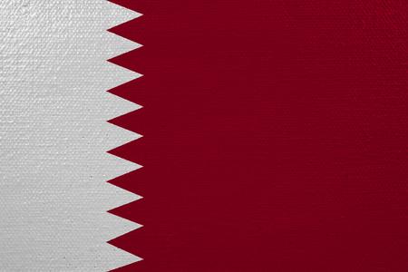 Qatar flag on canvas. Patriotic background. National flag of Qatar