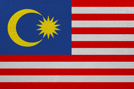 Malaysia flag on canvas. Patriotic background. National flag of Malaysia