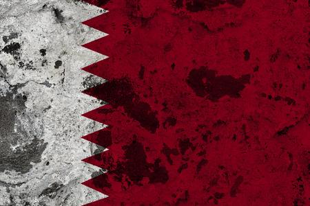 Qatar flag on old wall. Patriotic grunge background. National flag of Qatar