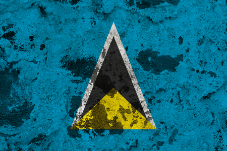 Saint Lucia flag on old wall. Patriotic grunge background. National flag of Saint Lucia