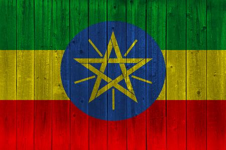 Ethiopia flag painted on old wood plank. Patriotic background. National flag of Ethiopia