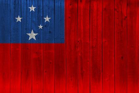 Samoa flag painted on old wood plank. Patriotic background. National flag of Samoa Stock Photo