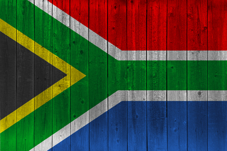 South Africa flag painted on old wood plank. Patriotic background. National flag of South Africa