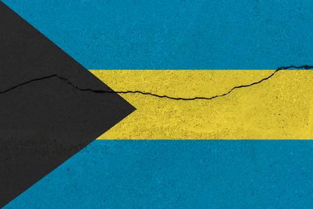 Bahamas flag on concrete wall with crack. Patriotic grunge background. National flag of Bahamas Stock Photo
