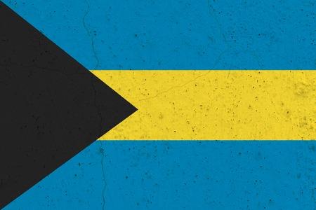 Bahamas flag on concrete wall. Patriotic grunge background. National flag of Bahamas Stock Photo