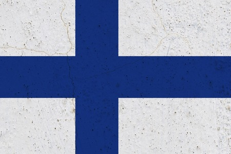 Finland flag on concrete wall. Patriotic grunge background. National flag of Finland