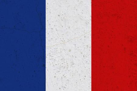 France flag on concrete wall. Patriotic grunge background. National flag of France