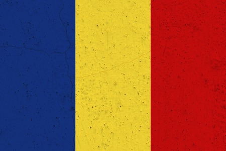 Romania flag on concrete wall. Patriotic grunge background. National flag of Romania