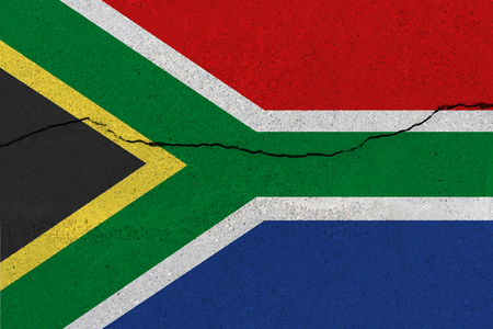 South Africa flag on concrete wall with crack. Patriotic grunge background. National flag of South Africa Imagens