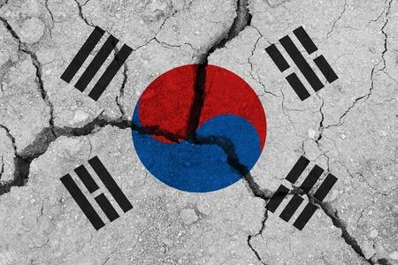 South korea flag on the cracked earth. National flag of South korea. Earthquake or drought concept