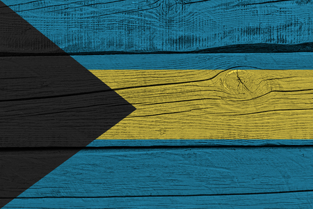 Bahamas flag painted on old wood plank. Patriotic background. National flag of Bahamas Stock Photo