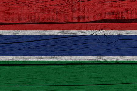 Gambia flag painted on old wood plank. Patriotic background. National flag of Gambia