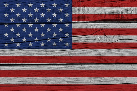 United States of America flag painted on old wood plank. Patriotic background. National flag of United States of America