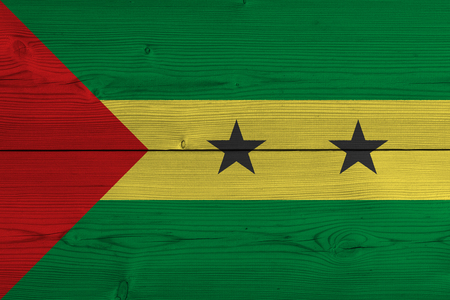 Sao Tome and Principe flag painted on old wood plank. Patriotic background. National flag of Sao Tome and Principe