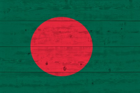 Bangladesh flag painted on old wood plank. Patriotic background. National flag of Bangladesh