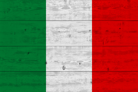 Italy flag painted on old wood plank. Patriotic background. National flag of Italy