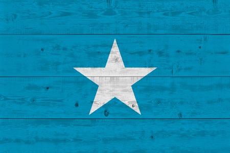 Somalia flag painted on old wood plank. Patriotic background. National flag of Somalia