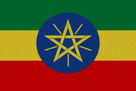 Ethiopia fabric flag. Patriotic background. National flag of Ethiopia