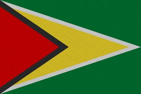 Guyana fabric flag. Patriotic background. National flag of Guyana Stock Photo