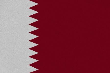 Qatar fabric flag. Patriotic background. National flag of Qatar Stock Photo