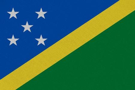 Solomon Islands fabric flag. Patriotic background. National flag of Solomon Islands
