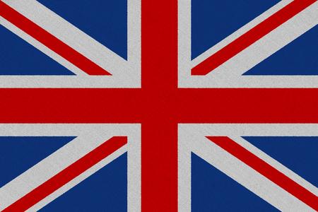 United Kingdom fabric flag. Patriotic background. National flag of United Kingdom Reklamní fotografie