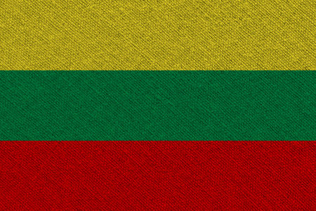 lithuania fabric flag. Patriotic background. National flag of lithuania 스톡 콘텐츠