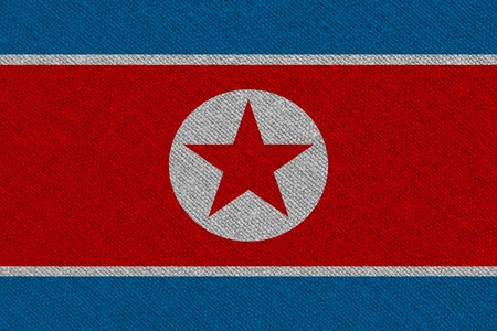 North Korea fabric flag. Patriotic background. National flag of North Korea
