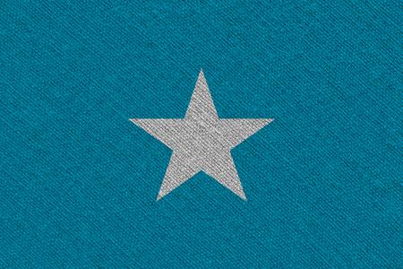 Somalia fabric flag. Patriotic background. National flag of Somalia