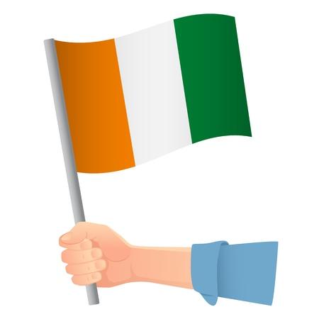 Cote divoire - Ivory Coast flag in hand. Patriotic background. National flag of Cote divoire - Ivory Coast illustration