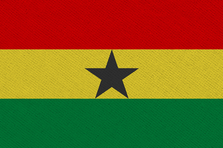 Ghana fabric flag. Patriotic background. National flag of Ghana 免版税图像