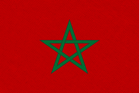 Morocco fabric flag. Patriotic background. National flag of Morocco Banco de Imagens