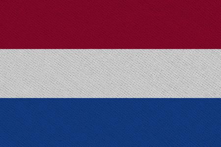 Netherlands fabric flag. Patriotic background. National flag of Netherlands Banco de Imagens