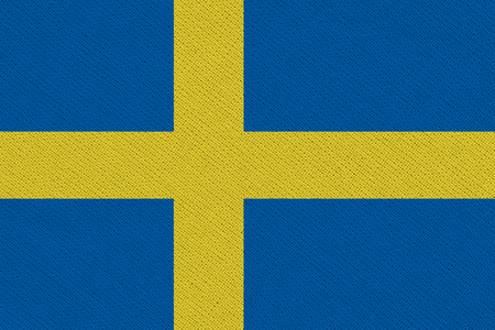 Sweden fabric flag. Patriotic background. National flag of Sweden