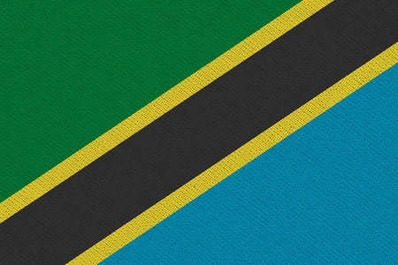 Tanzania fabric flag. Patriotic background. National flag of Tanzania
