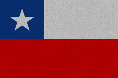 Chile flag painted on paper. Patriotic background. National flag of Chile