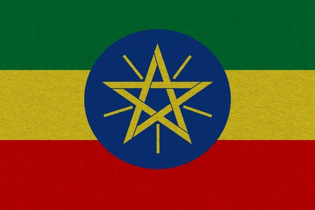 Ethiopia flag painted on paper. Patriotic background. National flag of Ethiopia