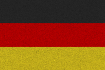 Germany flag painted on paper. Patriotic background. National flag of Germany