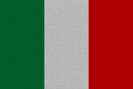 Italy flag painted on paper. Patriotic background. National flag of Italy Imagens