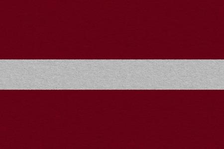 latvia flag painted on paper. Patriotic background. National flag of latvia