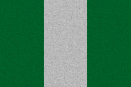 Nigeria flag painted on paper. Patriotic background. National flag of Nigeria