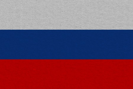 Russia flag painted on paper. Patriotic background. National flag of Russia