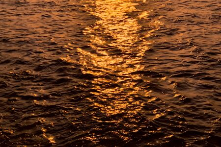 Sun reflections in the sea. Ripples on the surface of the water Imagens