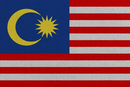 Malaysia fabric flag. Patriotic background. National flag of Malaysia