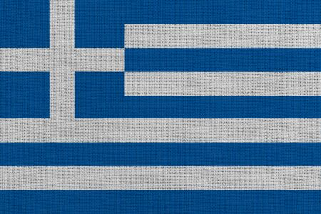 Greece fabric flag. Patriotic background. National flag of Greece