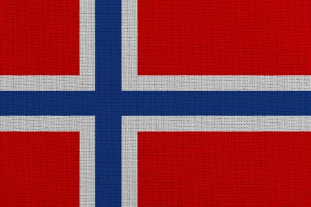 Norway fabric flag. Patriotic background. National flag of Norway
