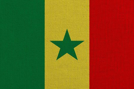 Senegal fabric flag. Patriotic background. National flag of Senegal